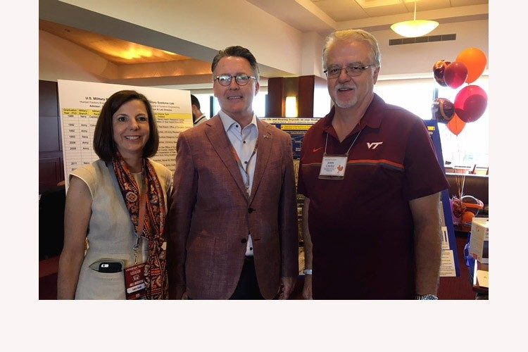 Dr. Laura Sands, President Tim Sands, and Dr. John Casali