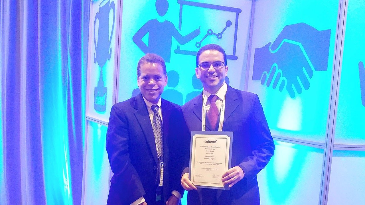 Mohammed Shafae receiving INFORMS at Student Chapter award