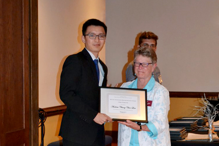 ISE M.S. student Andrew Law (left) received the 2018 Outstanding Master's Student of the College of Engineering from Graduate School Dean Karen DePauw.