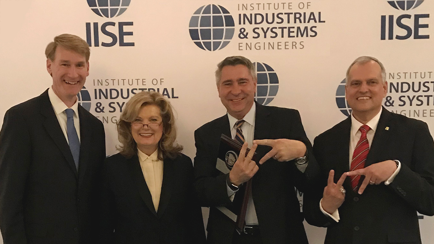Don Taylor (second from right) with Joe Hartman (immediate past president IISE), Jamie Rogers (president-elect IISE), and Tim McGlothlin (president IISE)