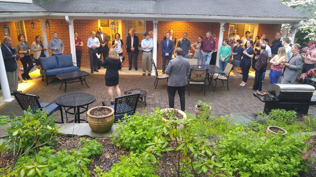 Dr. Eileen Van Aken (left front, with back to camera) welcomes local alumni to her home for a special ISE Alumni event in Blacksburg.