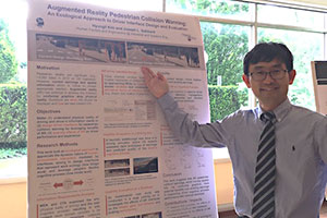Hyungil Kim at Torgersen Graduate Research poster session