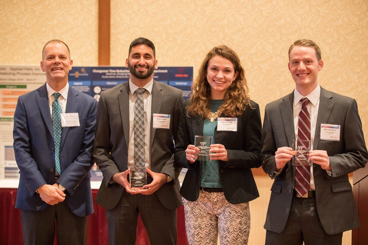 People's Choice award to Team 40 (from left): ISE Advisory Board chair Christian Johnson, Kunal Gandhi, Rachel Carie, Matthew Boys